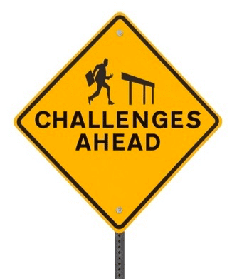 "Street sign reading ""challenges ahead"""